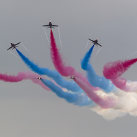 Buy canvas prints of Red Arrows and coloured smoke by Kenneth Dear
