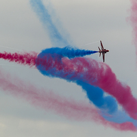 Buy canvas prints of Two Red arrows crossing with smoke on by Kenneth Dear