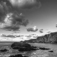 Buy canvas prints of Clouds Over Hartland Quay by Mike Gorton