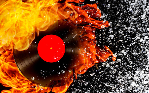 vinyl record with fire and water Canvas print by Guido Parmiggiani