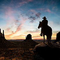 Buy canvas prints of Silhouette of a cowboy at sunset by Guido Parmiggiani