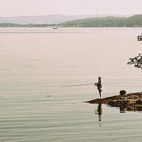 Buy canvas prints of FISHING IN THE LOCH by len milner