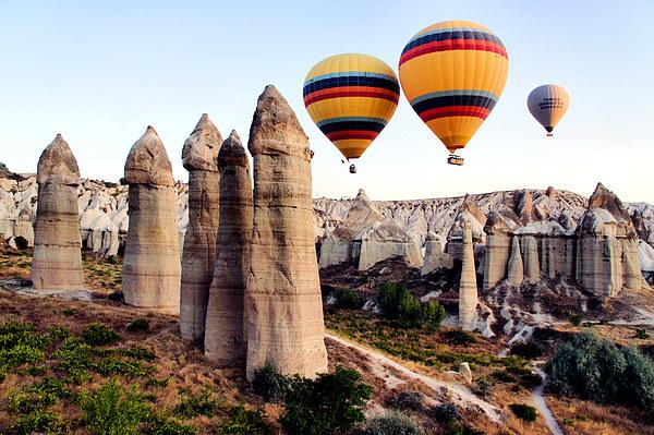 Balloons, Fairy Chimneys, Cappadocia, Turkey Print by Geoffrey Higges
