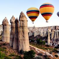 Buy canvas prints of Balloons, Fairy Chimneys, Cappadocia, Turkey by Geoffrey Higges