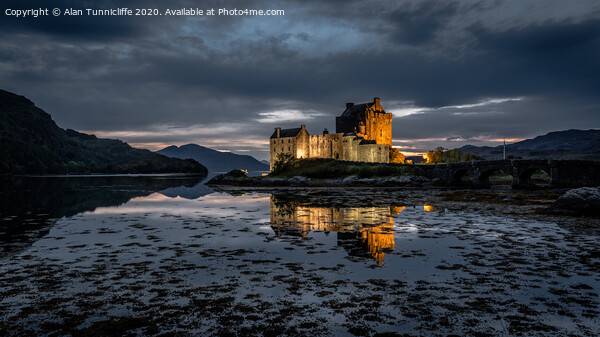 Eilean Donan in the blue hour Framed Mounted Print by Alan Tunnicliffe
