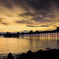 Buy canvas prints of  Sunrise at Llandudno Pier by Christine Smart