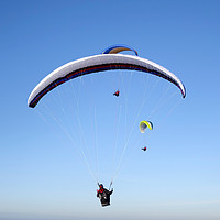 Buy canvas prints of Paragliders, Westbury White Horse, Wiltshire, UK by Andrew Harker