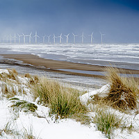Buy canvas prints of Cold conditions on a deserted beach with snowy cli by Peter Jordan