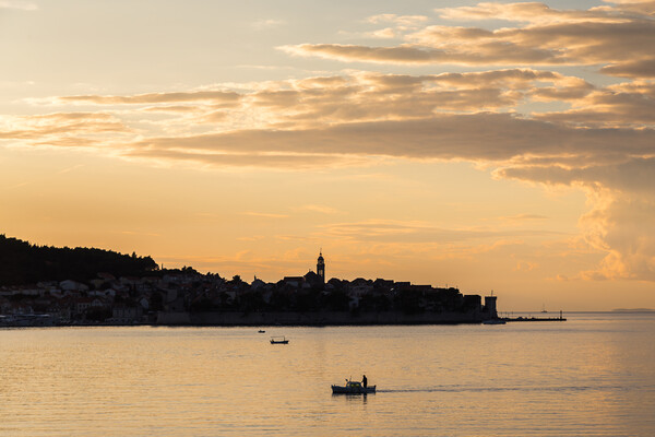 Fisherman in front of Korcula old town Print by Jason Wells