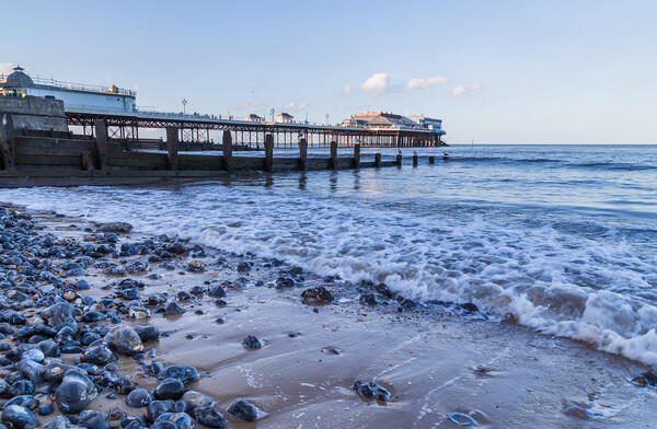 Waves lap the beach at Cromer Print by Jason Wells