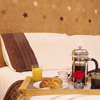 Buy canvas prints of Romantic Continental  Breakfast in Bedroom by Richard Pinder