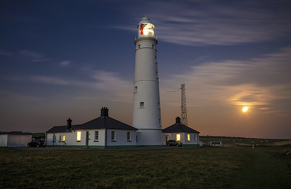 Nash point Lighthouse Canvas print by Dean Merry