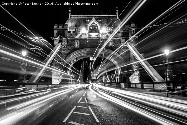 Light Trails in Monochrome. Canvas print by Peter Bunker