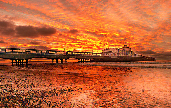Under the fire sky. Canvas Print by paul cobb