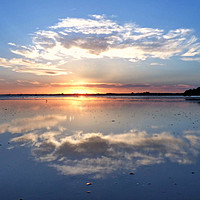 Buy canvas prints of Reflection of a sunset. by paul cobb