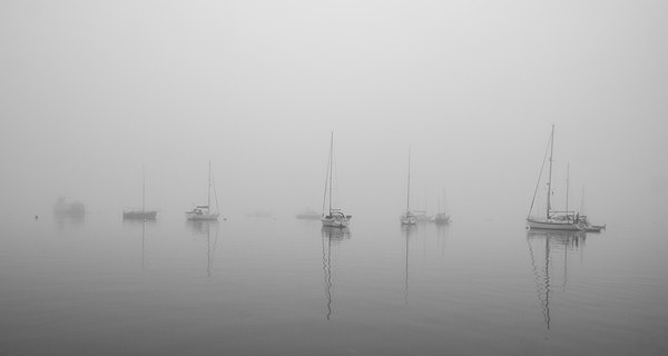 Tobermory in a summer fog Canvas print by Ian Young