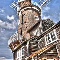 Buy canvas prints of  The Windmill at Cley by Graham Thomas