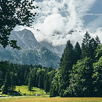 Buy canvas prints of Zugspitze In Clouds by Patrycja Polechonska