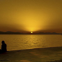 Buy canvas prints of A Croatian Sunset For Two in Zadar by William Duggan