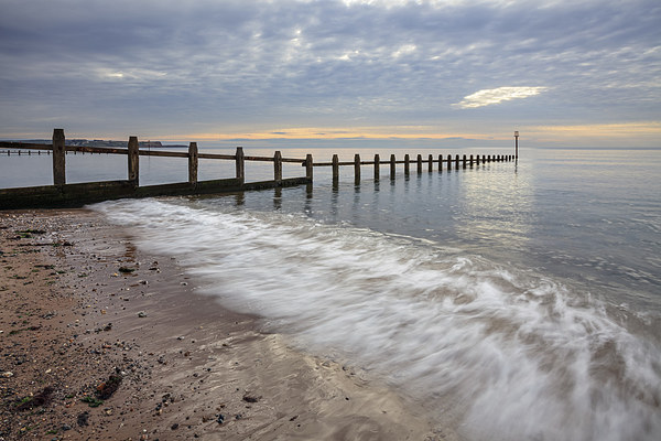 Groynes at Dawlish Warren Canvas print by Andrew Ray