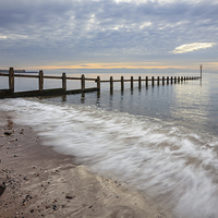 Buy canvas prints of Groynes at Dawlish Warren by Andrew Ray