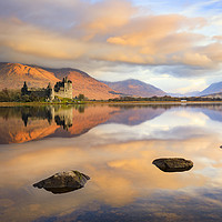 Buy canvas prints of First light on Kilchurn Castle by Andrew Ray