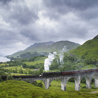 Buy canvas prints of Jacobite Express crossing Glenfinnan Viaduct by Howard Kennedy