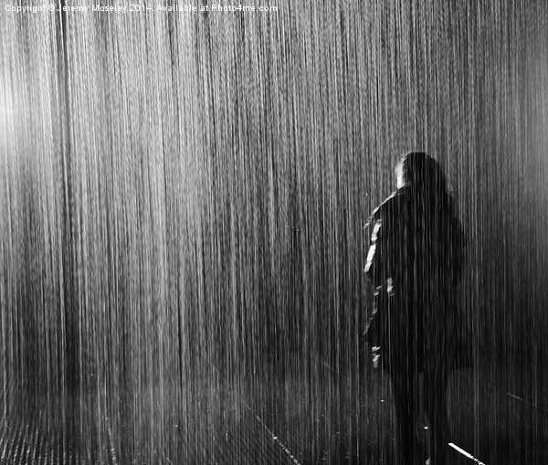 Lone figure standing in the rain Canvas print by Jeremy Moseley