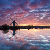 Buy canvas prints of  Thurne Windmill at Sunrise, Norfolk Broads. by Richard Bowden