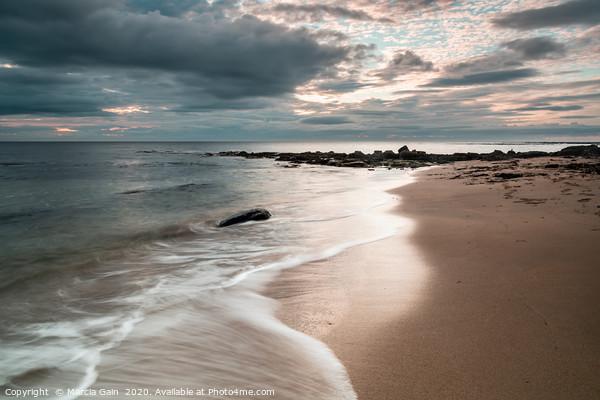 Northumberland coast at sunrise Canvas Print by Marcia Gain