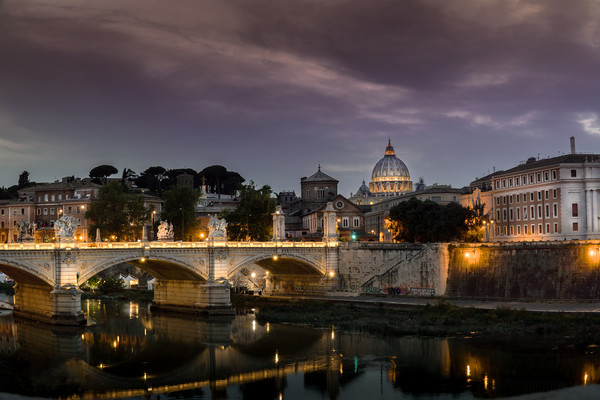 St Peters Basilica and Ponte Sant Angelo in Rome Canvas print by Chris Jones