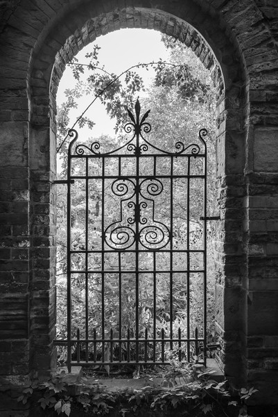 Old gate in an English walled garden Canvas Print by Andrew Kearton