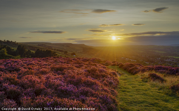 The sun setting over Ilkley Moor Canvas print by David Oxtaby