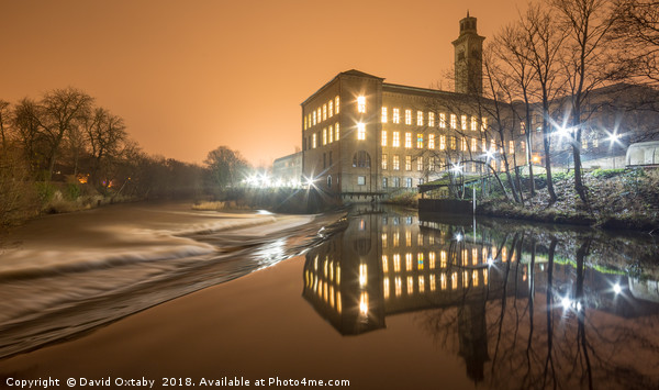Saltaire on a misty night Canvas print by David Oxtaby