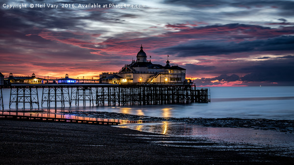 Sunrise Over The Pier Canvas print by Neil Vary