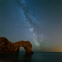 Buy canvas prints of Milky Way over Durdle Door by sharpimage.net