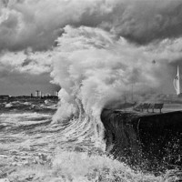 Buy canvas prints of Waves crashing over sea wall by sharpimage.net