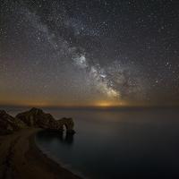 Buy canvas prints of  Milky Way over Durdle Door by sharpimage.net
