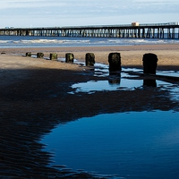 Buy canvas prints of  The Pier by Kish Woolmore