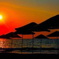 Buy canvas prints of Digital painting of beach umbrellas at sunset by ken biggs