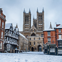 Buy canvas prints of Lincoln Cathedral and a snowy Bailgate by Andrew Scott