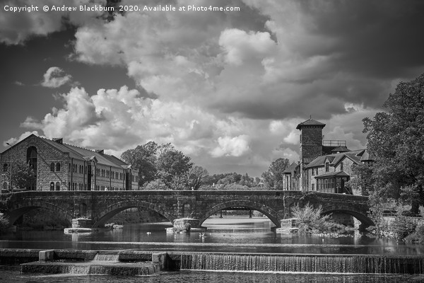 Clouds over the River Kent in Kendal...            Canvas print by Andrew Blackburn