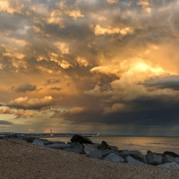 Buy canvas prints of Lancing Beach with dramatic clouds by Len Brook
