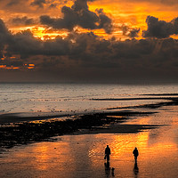 Buy canvas prints of Sunset walkers on Worthing Beach by Len Brook