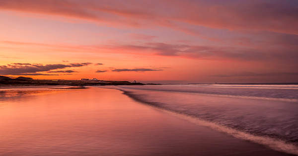 Red Sky at Bamburgh Beach Canvas print by Philips Photography