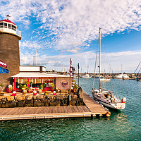 Buy canvas prints of Playa Planca Lighthouse Cafe by Phil Naylor