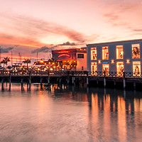 Buy canvas prints of Sunset shopping at the Marina by Phil Naylor