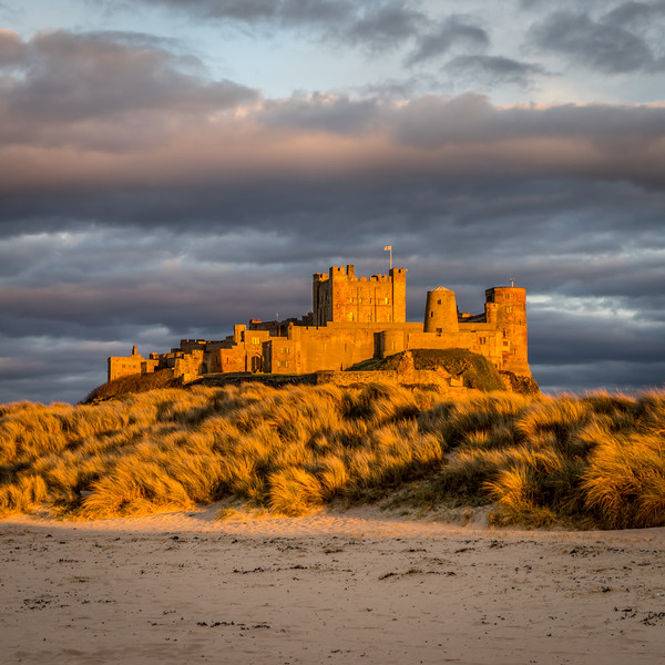 Sunset at Bamburgh Castle Canvas print by Naylors Photography