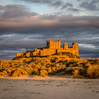 Buy canvas prints of Sunset at Bamburgh Castle by Naylors Photography