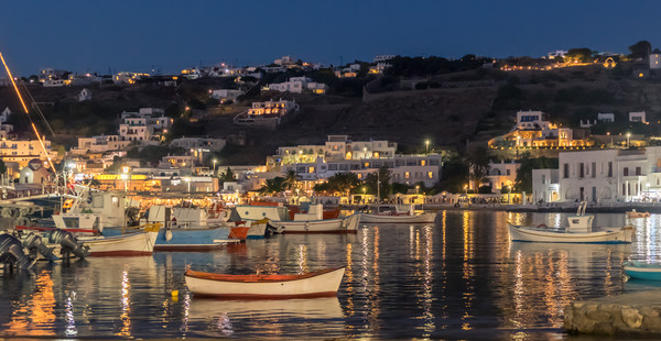 Fishing boats at night in Mykonos town Canvas print by Naylors Photography